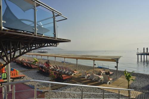 Пляж отеля Orange County Resort Kemer 5*